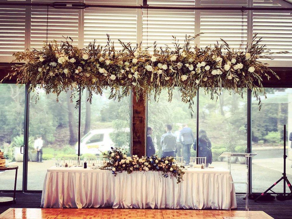 hanging arrangement flowers wedding.jpg