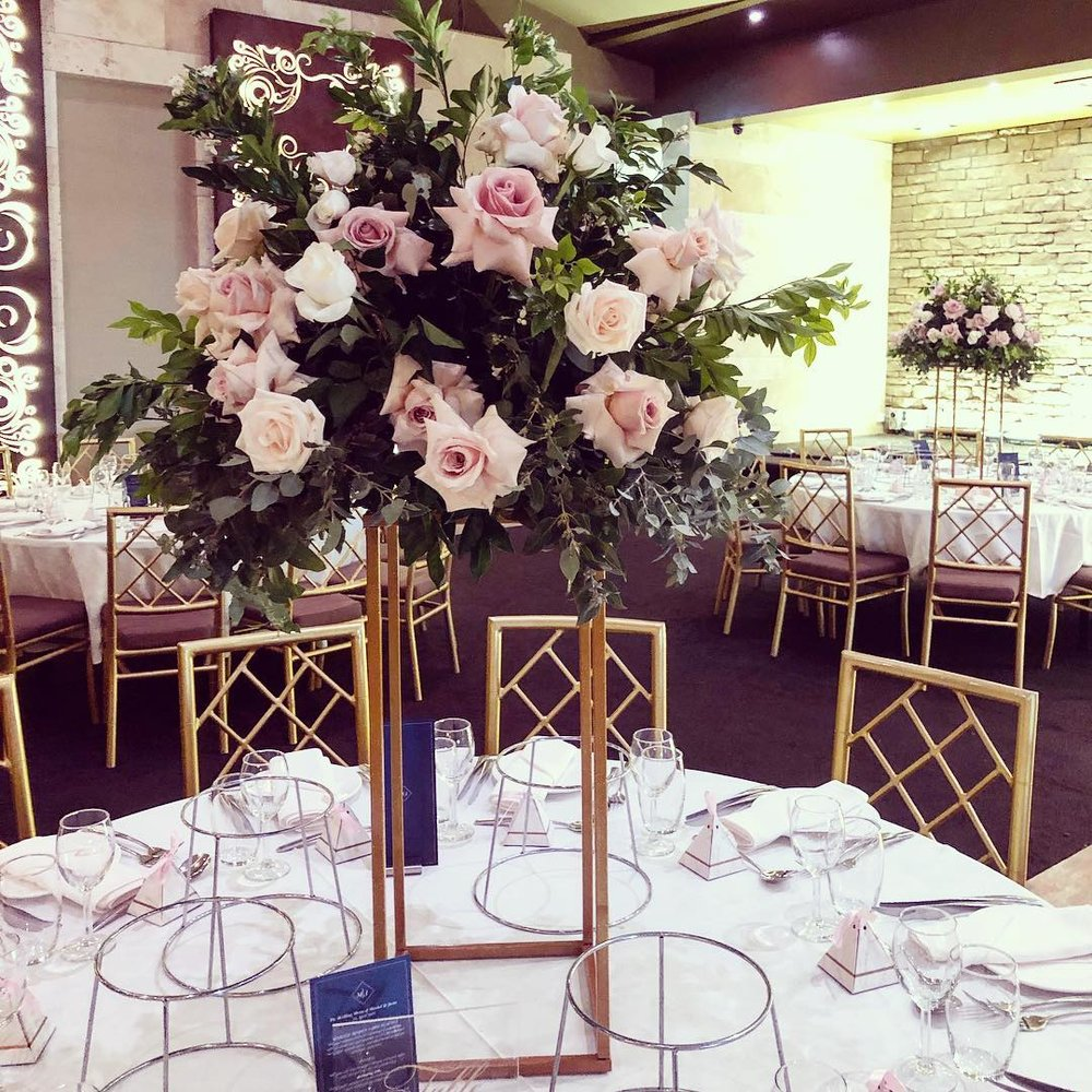 table centerpieces on tall stands.jpg