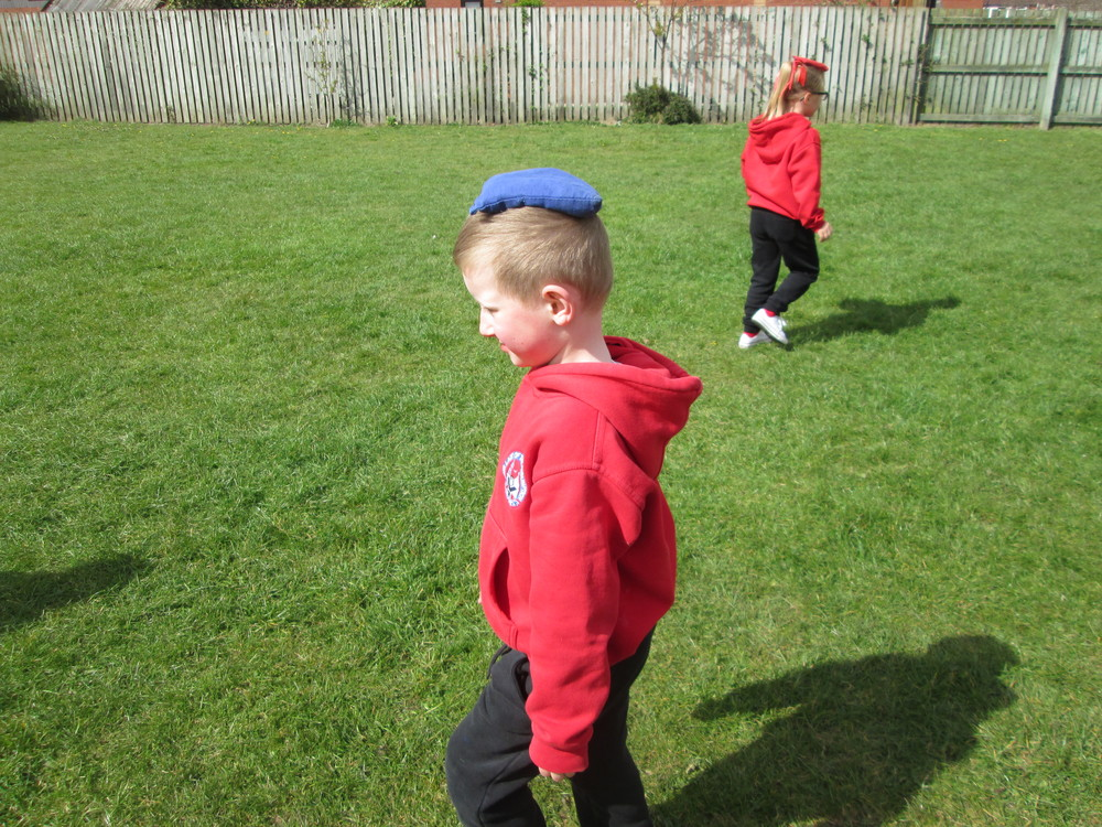 Here we are doing PE in the sunshine.  Great balancing Charlie.