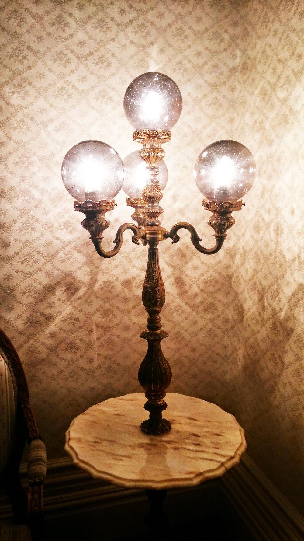 Vintage lamp illuminates our middle visitation room.
