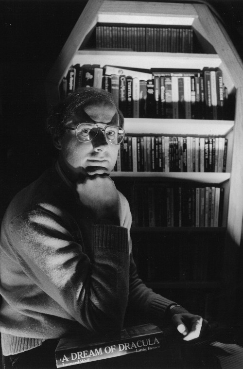 Author's photo for The Vampire in Verse: An Anthology. The custom-made coffin-shaped bookshelf housed Moore' s vampire library, 1984. (Photo by Rhoda Pollack)