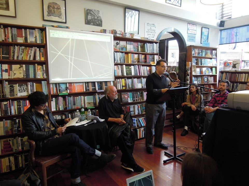 Peter Maravelis (right) introduces László Krasznahorkai (center) and Mauro Javier Cardenas (left) at City Lights Books on June 27, 2013.