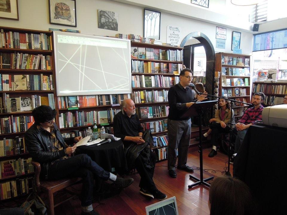 Peter Maravelis (right) introduces László Krasznahorkai (center) and Mauro Javier Cardenas (left) at City Lights Books on June 27, 2013.