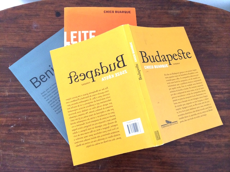 Brazilian editions of Chico Buarque's books, including an edition of  Budapest  with Buarque's name on front cover and a mirror-image back cover bearing Zsose Kósta's name.