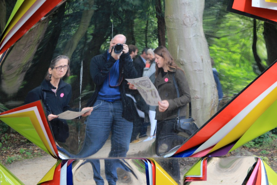 "Lydia Davis and Dan Gunn reflected in ""A Forest"" by Jim Lambie, at Jupiter Artland, Scotland, August 2014. Courtesy Dan Gunn."