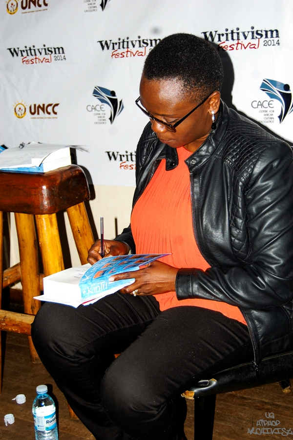 Jennifer Nansubuga Makumbi signing copies of  Kintu  at the Writivism Festival in June 2014. Courtesy Writivism.