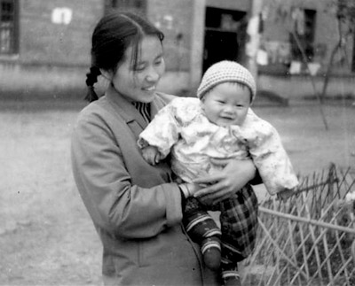 Can Xue with her son at 6 months, 1979.