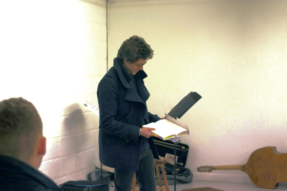 Adam Thirwell prepares to read from his novel, Lurid & Cute.