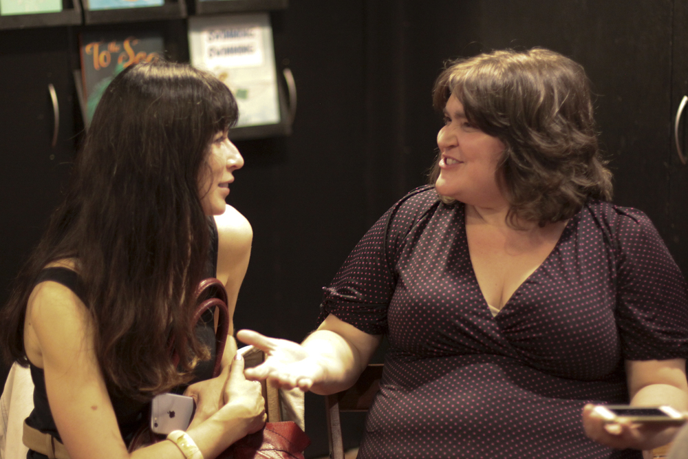 Emily Cooke (left) chats with Luthien Brackett.