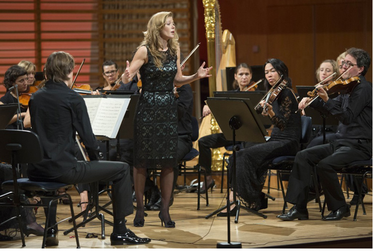 Barbara Hannigan conducting & singing with the Mahler Chamber Orchestra (image credit: Lucerne Festival)