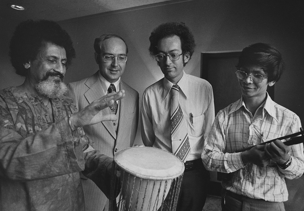 Halim El-Dabh   demonstrates a drumming technique for ethnomusicologists William Anderson (second from left) & Terry E. Miller, & Thai graduate student Kovit Kantasiri  (courtesy Kent State University Libraries, Special Collections and Archives)