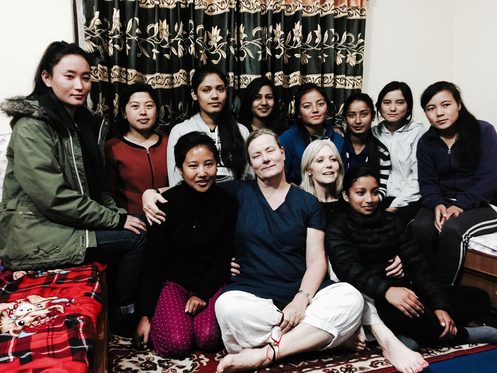 Eva Holmberg-Tedert (in the middle) and Jyoti Botsford (at Eva's left) with the medical, nursing and midwifery students in Kathmandu, Nepal.