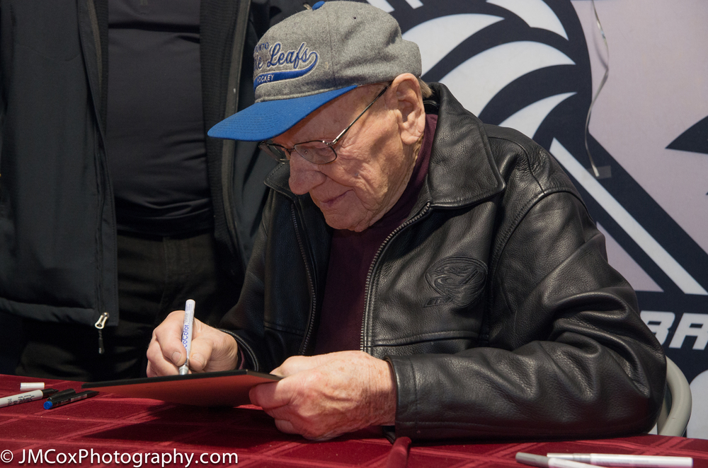 Hockey Hall of Fame Member Johnny Bower giving an autograph on his 90th Birthday