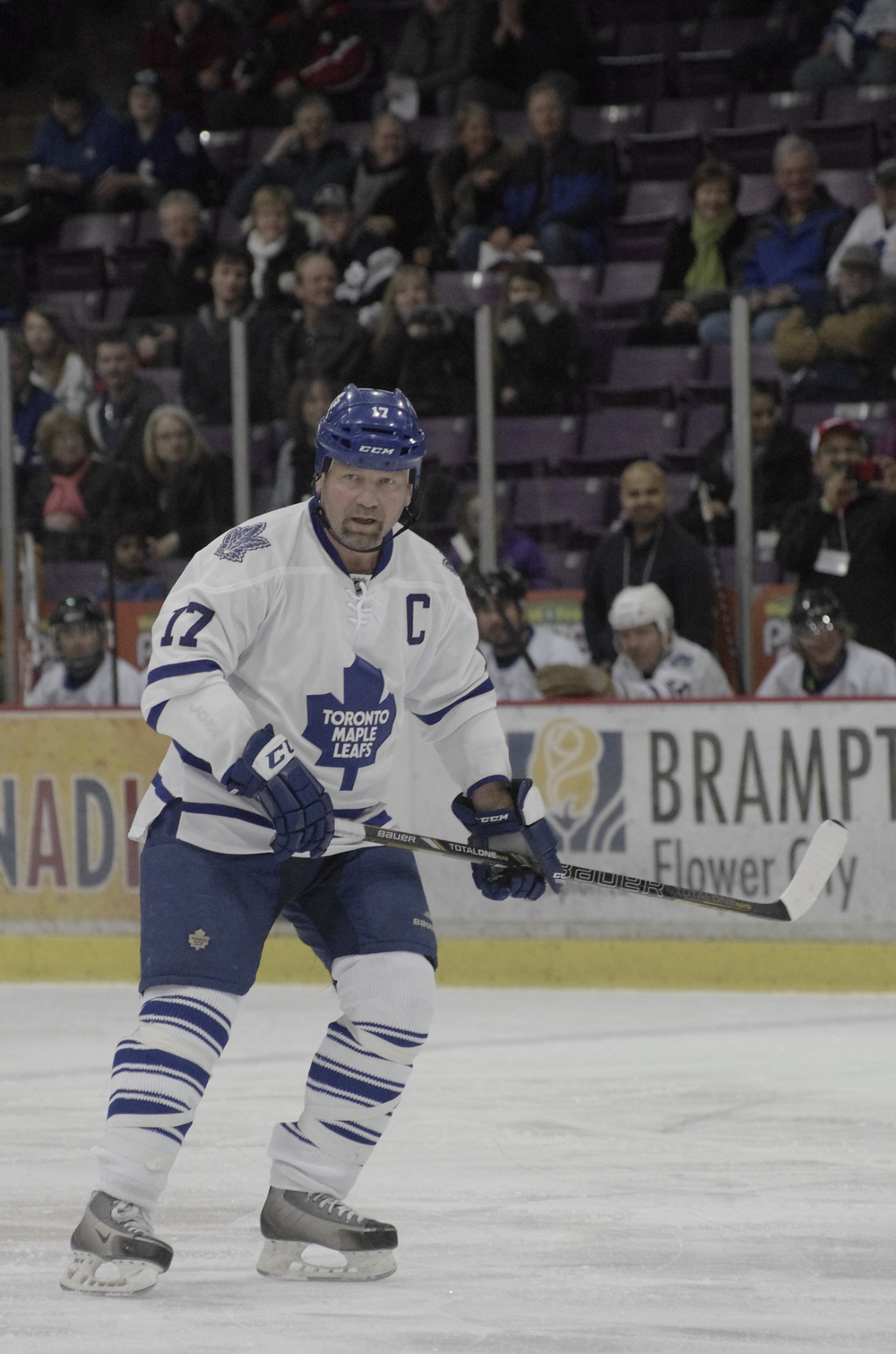 NHL alumnus Wendel Clark glances towards his teammates on the bench at a charity game at the Powerade Centre in Brampton, ON.  As published in Snapd Brampton, March 2015.
