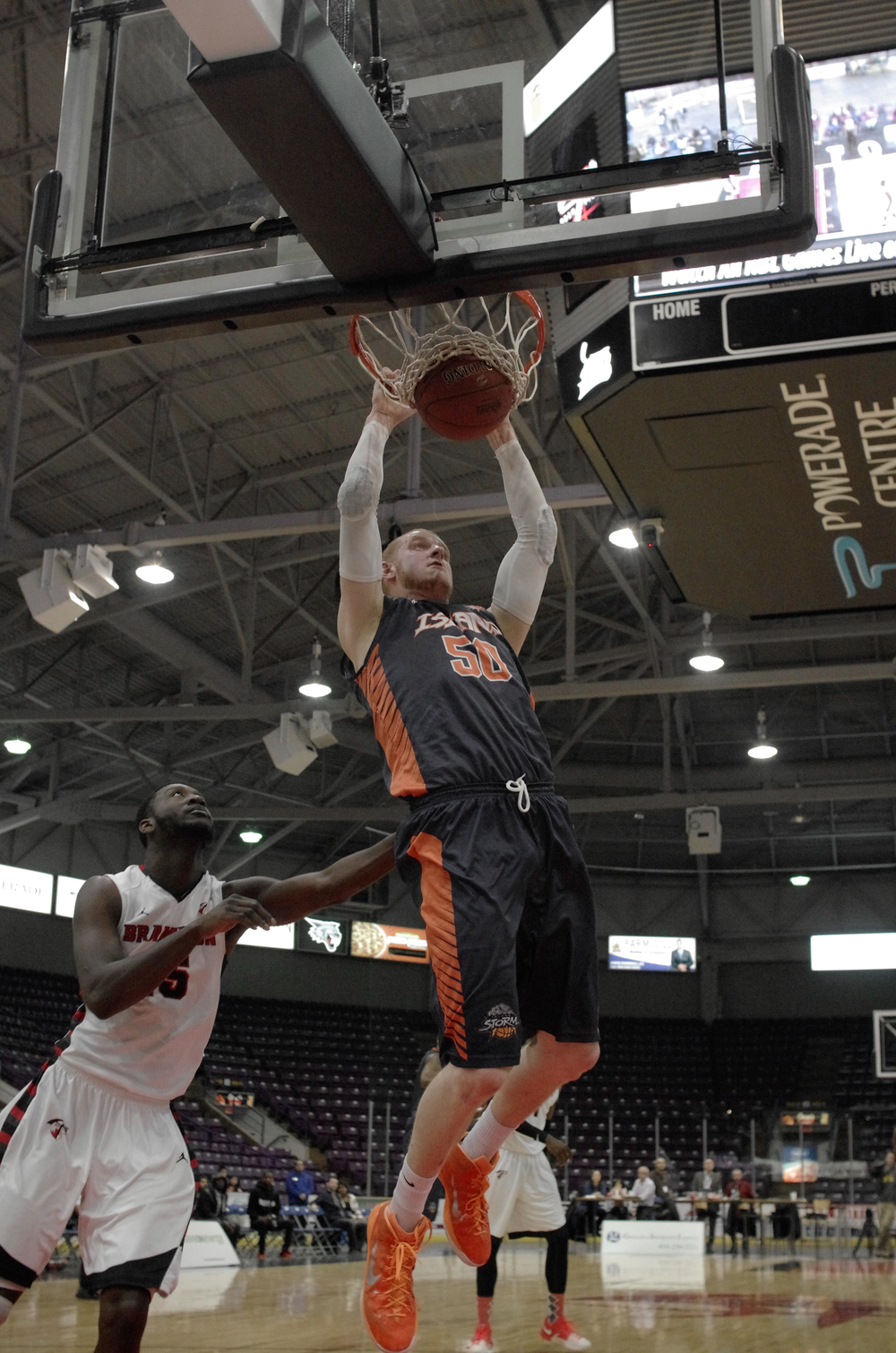 Nick Evans of the Charlottetown Island Storm completes a slam dunk in a game against the Brampton A's in the Powerade Centre in Brampton, Ontario, on January 29, 2015.  As Published in Snapd Brampton, March 2015.