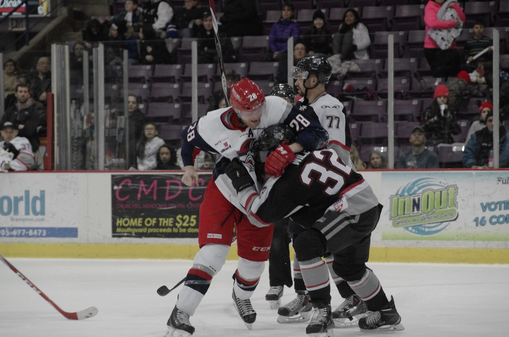 The Elimra Jackal's Andrew Conboy and the Brampton Beast's Cal Wild struggle in a fight at the Powerade Centre in Brampton, Ontario on January 25, 2015, which was a result of Conboy cross-checking Wild in the face.  As published in Snapd Brampton, March 2015