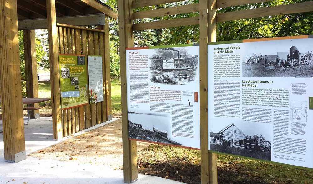 A beautiful shelter building with a picnic area was constructed for visitors to enjoy while reading signage about the park's history.