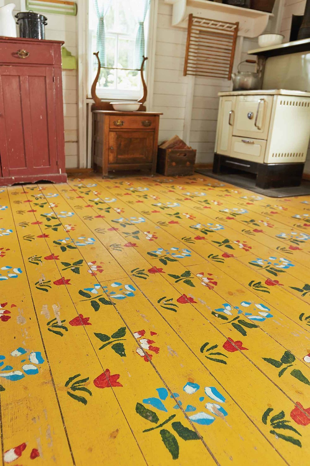 A replica of the Sommerfeld housebarn floor pattern, at the Mennonite Heritage Village, Steinbach, Manitoba, handpainted by M. Krahn, 2010.