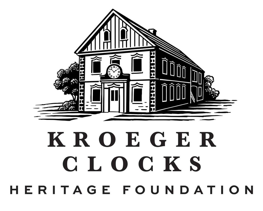 The Kroeger Clocks Heritage Foundation logo is based on the original Kroeger Clock and Motor Works factory, circa 1910.