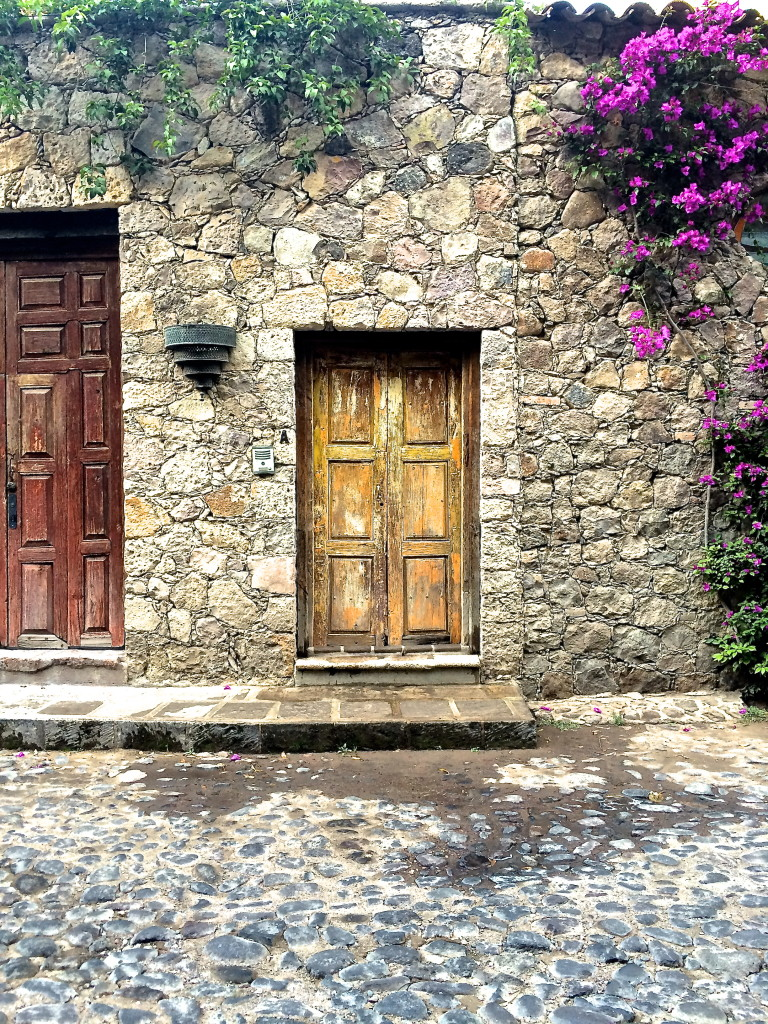 Stone, wood, and bouganvillea