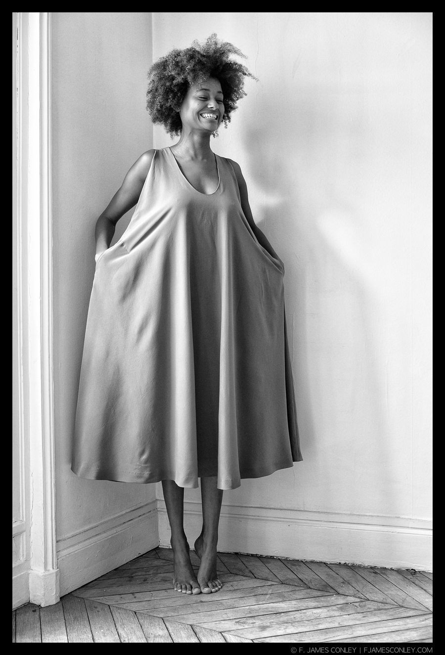 Working with CHV Design in Paris, the designer's primary concept with this dress was its drape—the way the fabric hangs and moves. Accordingly, the images about this dress emphasize its draping with movement.