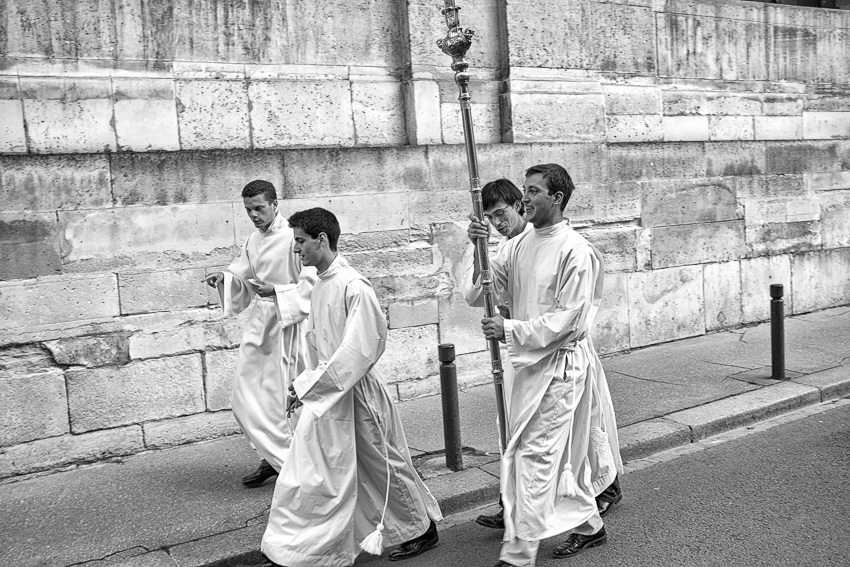Alter serves leaving the sacristy after a mass in Versailles.
