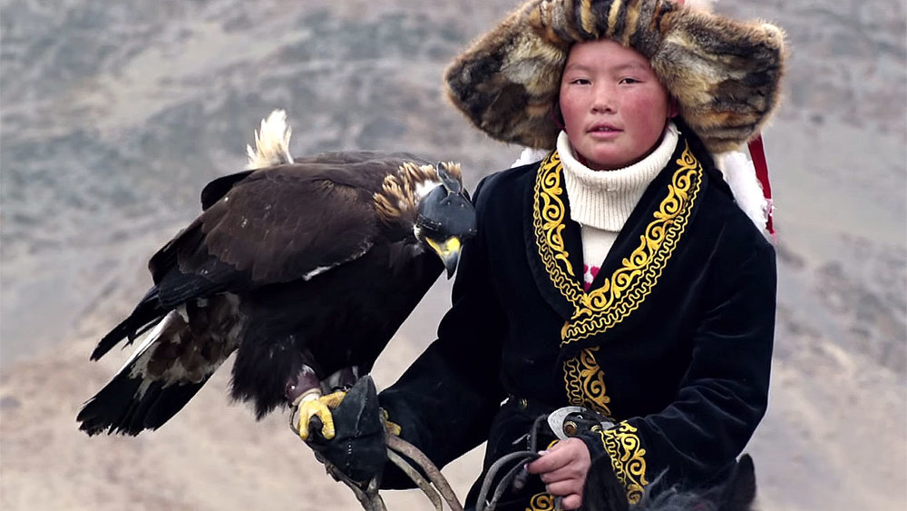 This spellbinding documentary follows Aisholpan, a 13-year-old nomadic Mongolian girl who is fighting to become the first female eagle hunter in twelve generations of her Kazakh family. Through breathtaking aerial cinematography and intimate verite footage, the film captures her personal journey while also addressing universal themes like female empowerment, the natural world, coming of age and the onset of modernity.