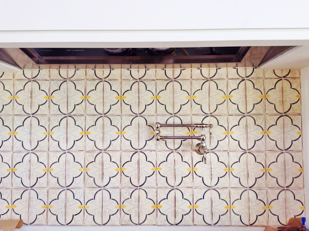Custom Tabarka Tile backsplash above the range.