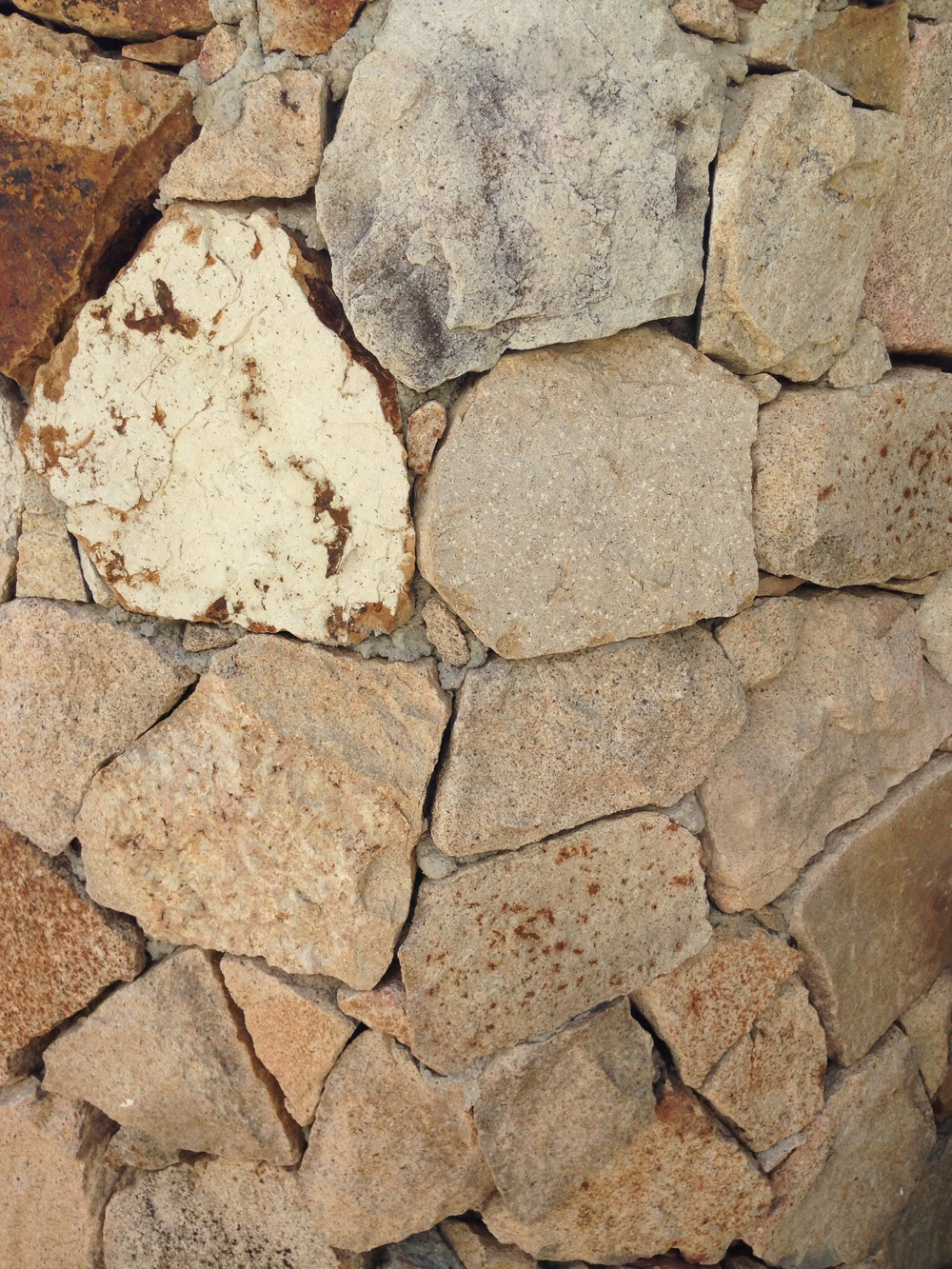 Hand-laid rock wall adds texture and a natural element.
