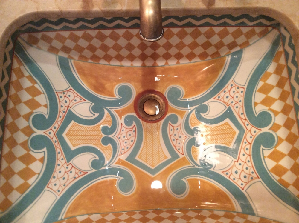 A beautiful ceramic sink to add color.