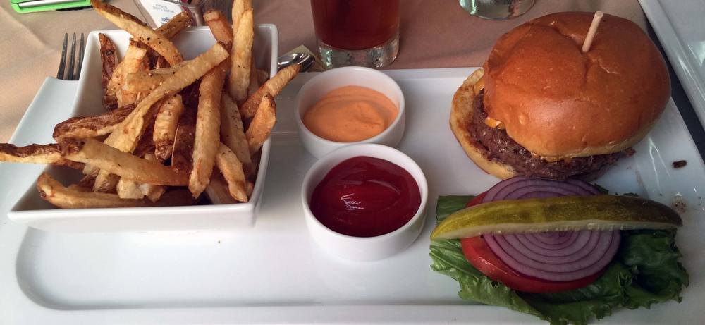 All-American Burger made with Akaushi Beef accompanied by handcut fries from Harwood Grill