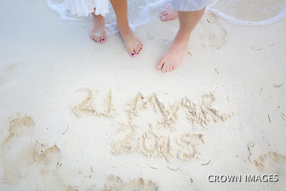 writing wedding date in the sand