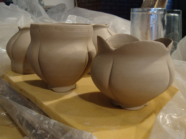 Made while in residence @ KHN Center in Nebraska City. Altering of wheel-thrown form in progress. Unfired.
