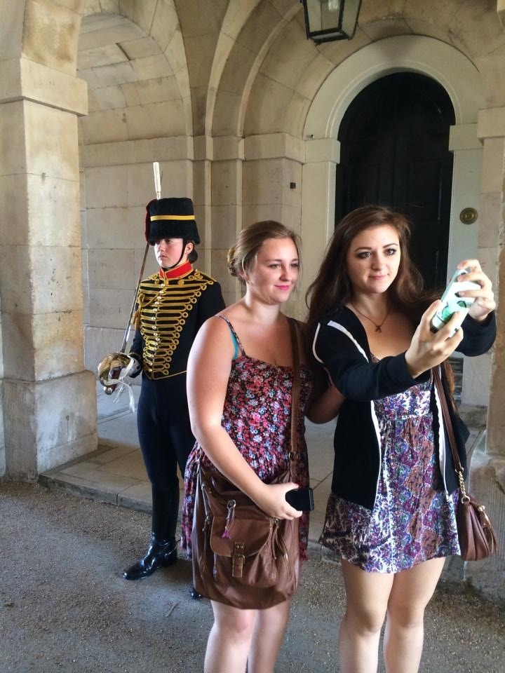 Monique's daughters taking a selfie with a Buckingham Palace guard