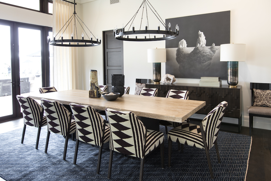 Hilltop Hacienda is an interior design project by Denise Morrison Interiors featuring a dining room with upholstered dining chairs and graphite artwork.