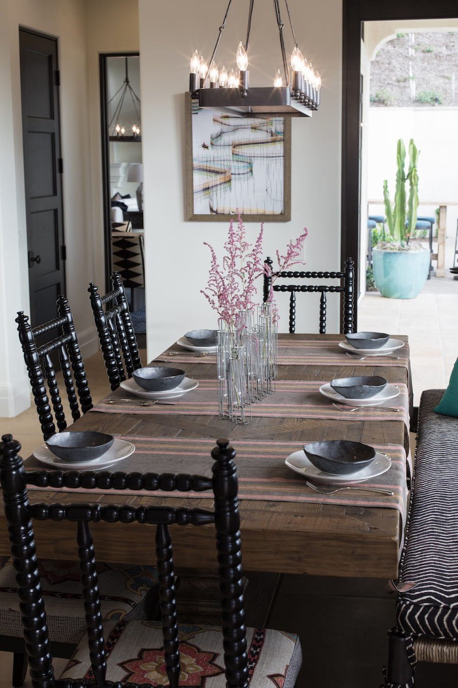 Hilltop Hacienda is an interior design project by Denise Morrison Interiors featuring a breakfast nook with tablewear and accessories.