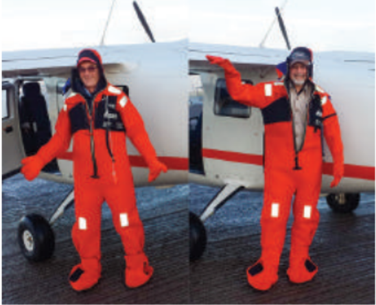 John and Mario preparing for trans north atlantic flight, wearing cold water immersion suits.