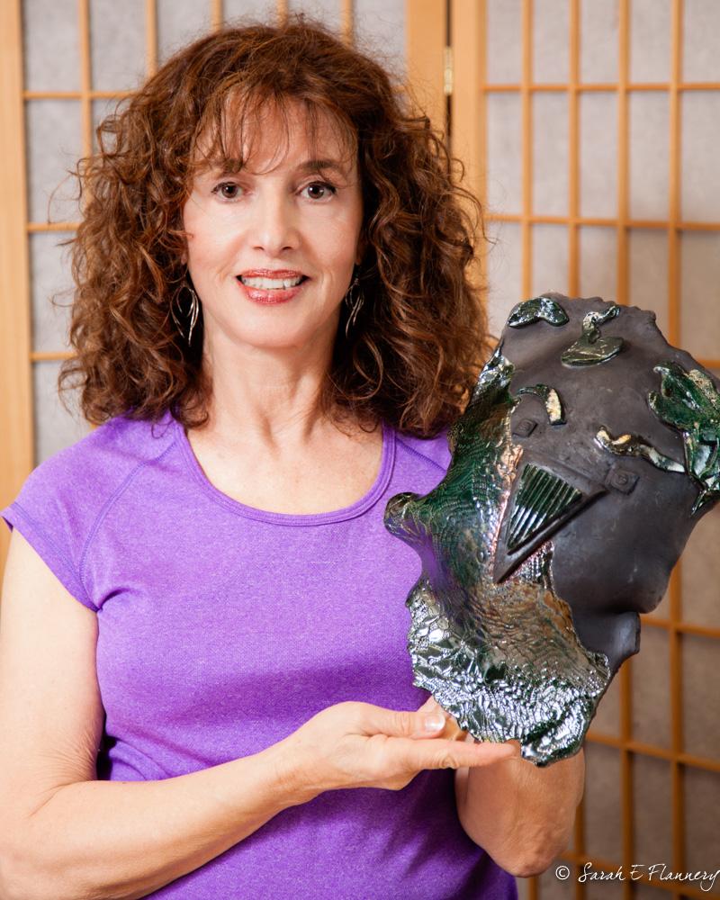 """Leslie Jacobsen, with her creation, """"Bird Man"""""""