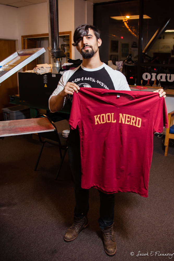 David showing a Kool Nerd T-shirt hot off the press