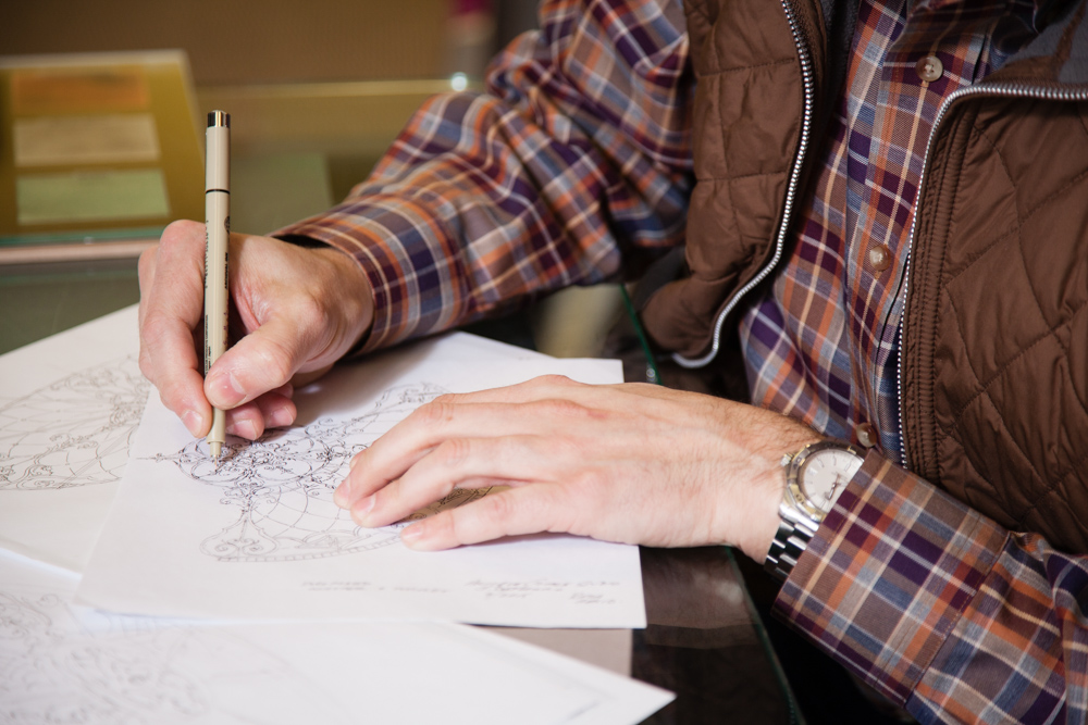 Jay creating one of his hand drawn designs