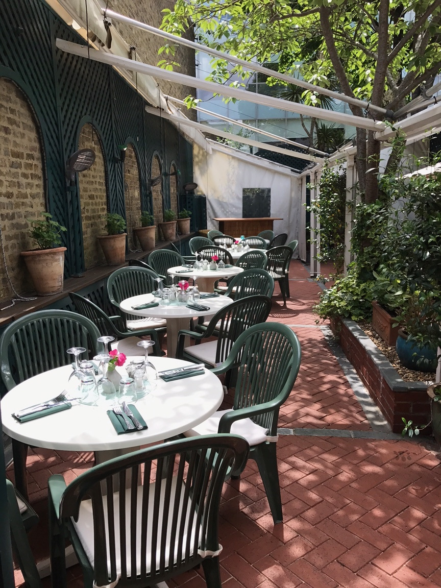 THE DINING COURTYARD IS A UNIQUE SPACE IN SUMMER