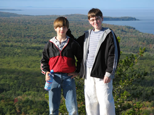 Ryan and Jeff on top of Hogback.   Lake Superior in background. Looking toward the northeast.