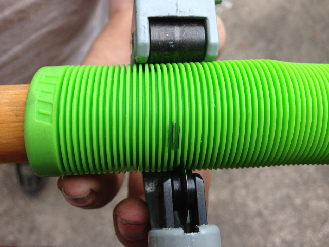 Employing a tubing cutter to shorten a grip.