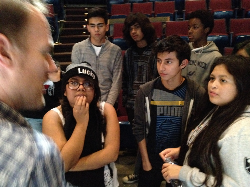 Dalia, left, listening to Director Christopher Cartmill talk about his rehearsal and tech process at Mason Gross School of the Arts tech/dress rehearsal.