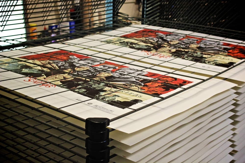 Detail : Screenprints drying in stacks before the final color is applied