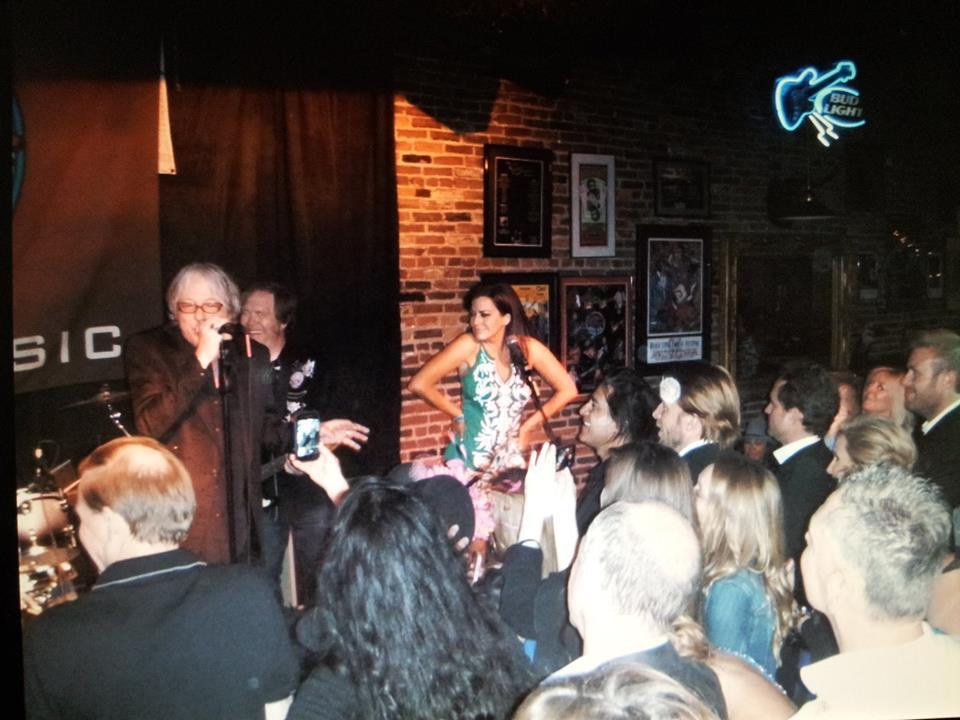 Robin Meade news anchor with Mike Mills bass player R.E.M singing with the predators at Stevie Rays Blues Bar