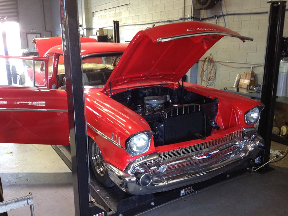 Trent put some finishing touches on our 57 Chev before it goes to the showroom