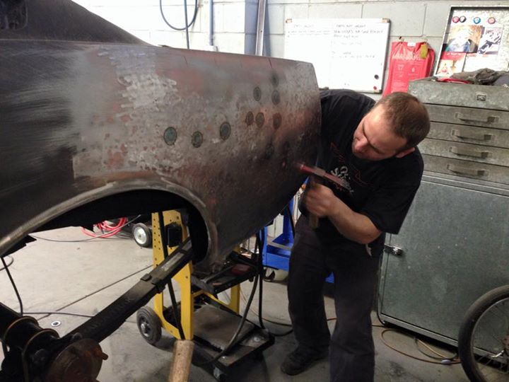 Roland shrinks the metal with a torch to get rid of some bulges left by the previous repairers.