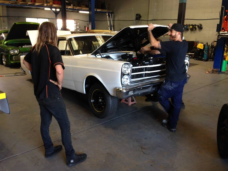 Jackie supervises Roland and our newbie Kezz as they mount the new bonnet.
