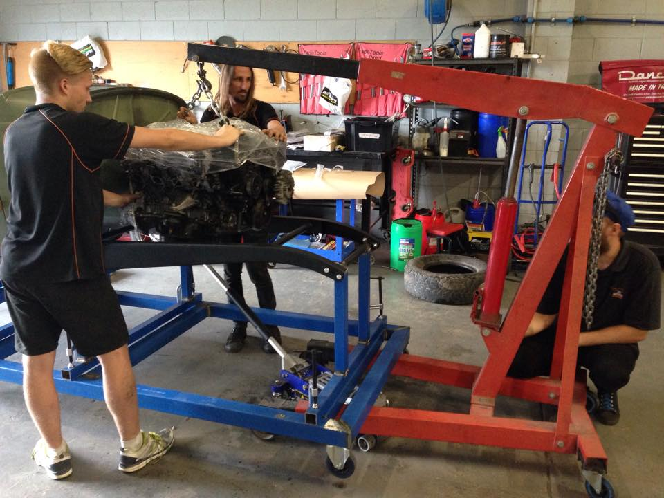 Jackie and Trent mock-up the motor to locate the engine mounts.